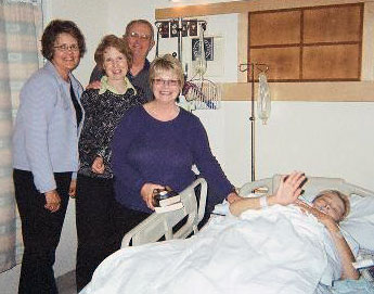 Art and Barbara (Boyd) Gropps, Connie Paris, and Launa (Oakes) Morasch visit Andrea after her first surgery.